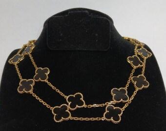 Van Cleef and Arpels necklace sale, 20 motifs. Stone is Black Onyx.