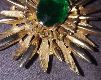 70s gold tone and emerald stone brooch