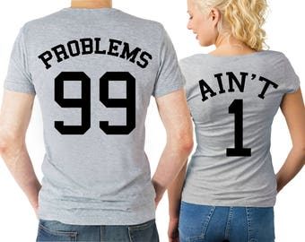 99 Problems, Ain't 1 couple matching heather grey T-shirts set with text on the back.