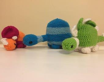 Three crochet dinosaurs, Stegasaurs, Brontosaurus/Diplodocus and Triceratops - Made to order