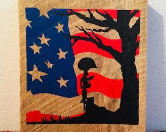 Fallen soldier memorial with flag & tree