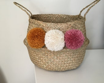 Seagrass belly basket with large pom poms