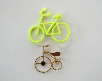 2 vintage bicycle pins . 1980s neon plastic bike pin brooch, gold tone penny farthing bicycle, high wheel or tricycle