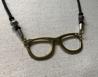 Gold glasses with rhinestone details beaded necklace