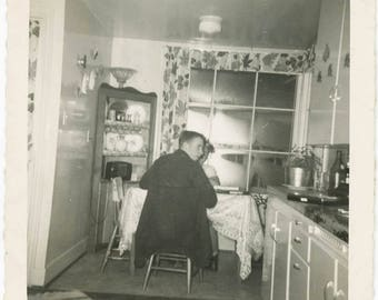 vintage photo 1950 abstract Man Turns from Back Sitting in Kitchen Mid Century Square Snapshot