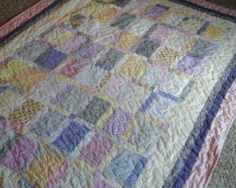 pink and yellow twin size quilt