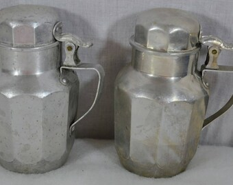 """Pair Vintage Pint Aluminum Syrup Decanters Servers Pitchers - One is Viko """"The Popular Aluminum""""  and One is Mirro """"The Finest Aluminum"""""""
