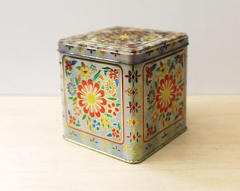 Vintage Daher tin container with floral design.