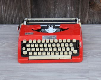 Red Brother Charger 11 Typewriter with Case. Works Great