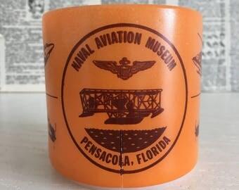 Vintage mug Naval Aviation Museum Pensacola Florida - helicopters - orange - milk glass - airplanes - jets - Navy