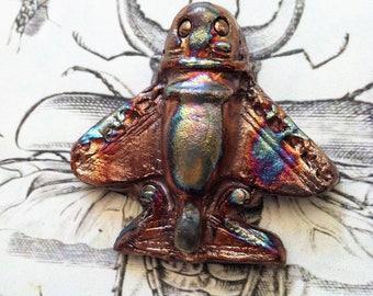 Wondrousstrange Raku Pre-Columbian Insectus Invictus II Blue Gold Purple Bronze Raku Pendant