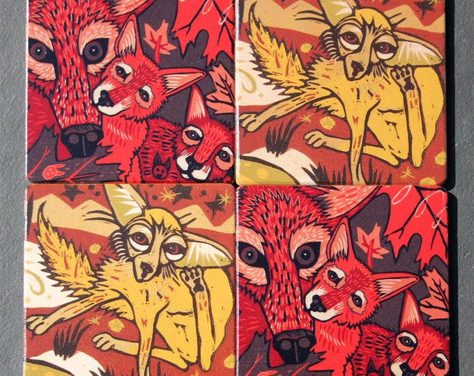 Wolf, fox, wood coasters, design by Jenny Pope