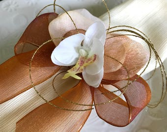 Napkin Rings - white and yellow orchid with amber ribbon, peach leaves and sparkle gold shoots