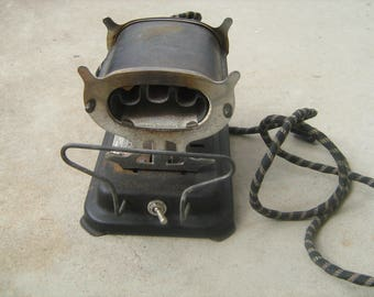 1930-40s antique solar electric beauty shop heater for heating curling irons for curling hair.