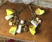 Chunky Yellow White Gold Tone Charm Bracelet Unsigned Leaves Nuggets Double Link Chain Boho Bohemian Lucite Beads Bead Caps