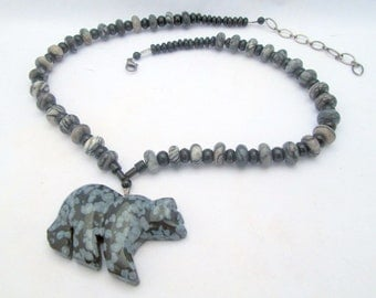 Necklace: snowflake obsidian bear pendant on a strand of zebra agate and black onyx/Choker for men and women