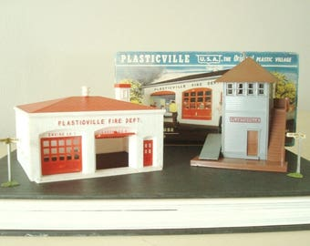 Plasticville Fire House 2409 and Switch Tower 1402, 1960s versions, classic train set accessories, Bachmann Bros. mid-century building toys