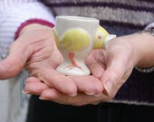 Set of two stoneware egg cups - chicken design glazed in simply clay