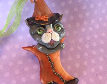 Halloween Witch Cat Ornament - gray tuxedo cat - Victorian boot  - handmade clay ornament  - one of a kind - whimsical decor- orange - green