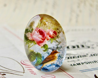 Songbird with crown, from our Beautiful Birds collection of handmade glass cabochons, 25x18mm oval, pink roses