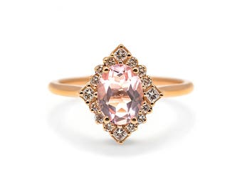 Kerry Ring - An oval morganite with an art deco inspired halo of diamonds