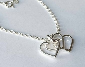 Sterling silver triple heart necklace, hallmarked in Edinburgh.