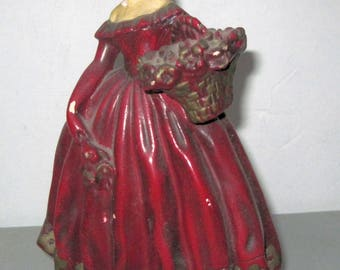 Vintage Chaulkware Figure of Lady in Red Dress holding basket of flowers