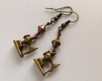 S E W - S T I T C H I N G - Brass sewing machine dangling earrings.
