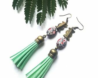Large, African brass pendant earrings//dramatic drop dangle earrings//leather tassel earrings//mint tassel earrings//long earrings