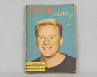 Wm. F. Kofoed Movie Diary, 1945, Van Johnson on cover, Record book listing the movie shows seen, Album of stars, Space for comments