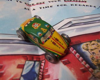 tiny tin toy car from japan