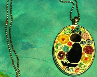 Mosaic left facing black cat oval pendant with millefiori background
