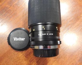 Vivitar 75-205 mm f/3.5-4.5 zoom lens in Canon FD mount skylight filter