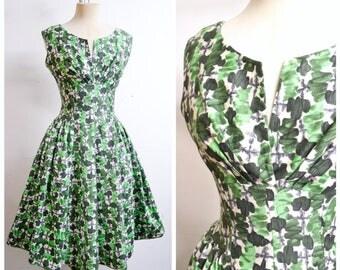 1950s Green white leaf print cotton full skirt day dress / 50s printed drop waist sleeveless summer dress - S