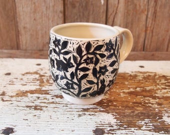 Cup in Black and White Stoneware with Bunnies and Flowers