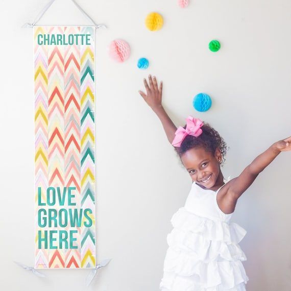 "Personalized ""Love Grows Here"" chevron canvas growth chart in pastels"
