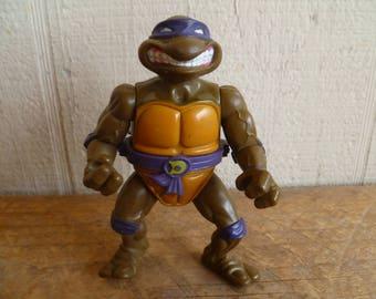 "Teenage Mutant Ninja Turtles Action Figure ""Donatello""  MIssing Shell"