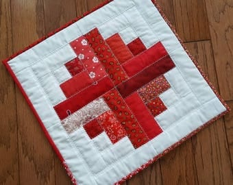 Handmade Quilted Table Mat in a variety of Reds, Log Cabin Pattern