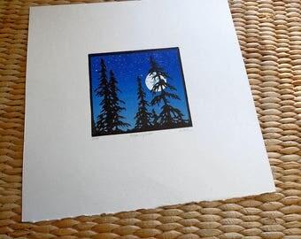 linocut of moon, stars and trees