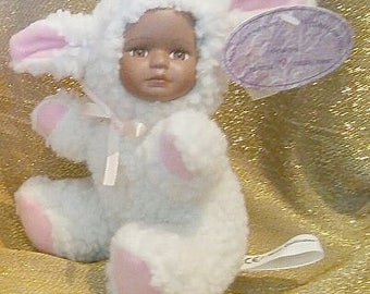 Baaby a pink and white plush baby lamb with porcelian African American face