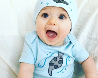 Otter light blue bodysuit and beanie hat on organic cotton matching baby shower set