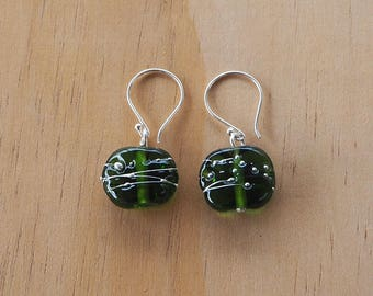 Green recycled glass earrings with fine silver wire. Beads made from a Moet Champagne bottle
