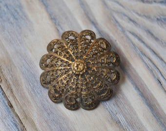 Antique filigree button.