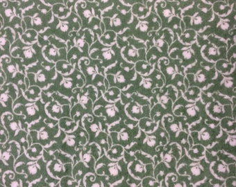 Green and white floral flannel fabric