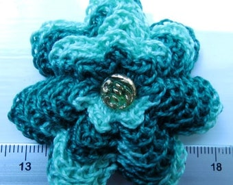 Irish crochet flower brooch in green cotton with vintage glass button centre