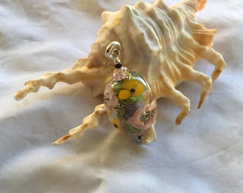 Handmade floral glass bead pendant with sterling silver bail.