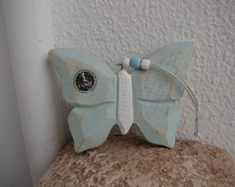pale blue, wooden butterfly with vintage stamp 1 franc design on wing-hanging carved wood butterfly
