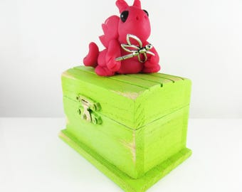 Polymer clay hot pink dragon on an old green treasure chest