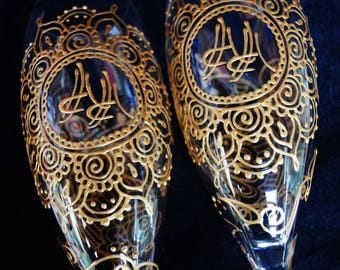 Bride & Groom toasting flutes CUSTOM henna style designs with monograms incorporated into design. One of a kind wedding glassware