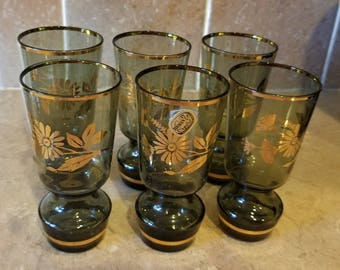 Six Bohemia Crystal cocktail drinking glasses  with gold glitz daisy flower over smoky grey glass gift idea.